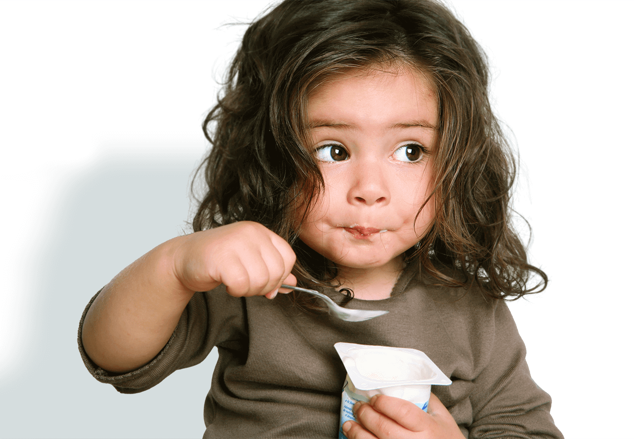 kids klubs gallery page banner photo of girl eating yogurt
