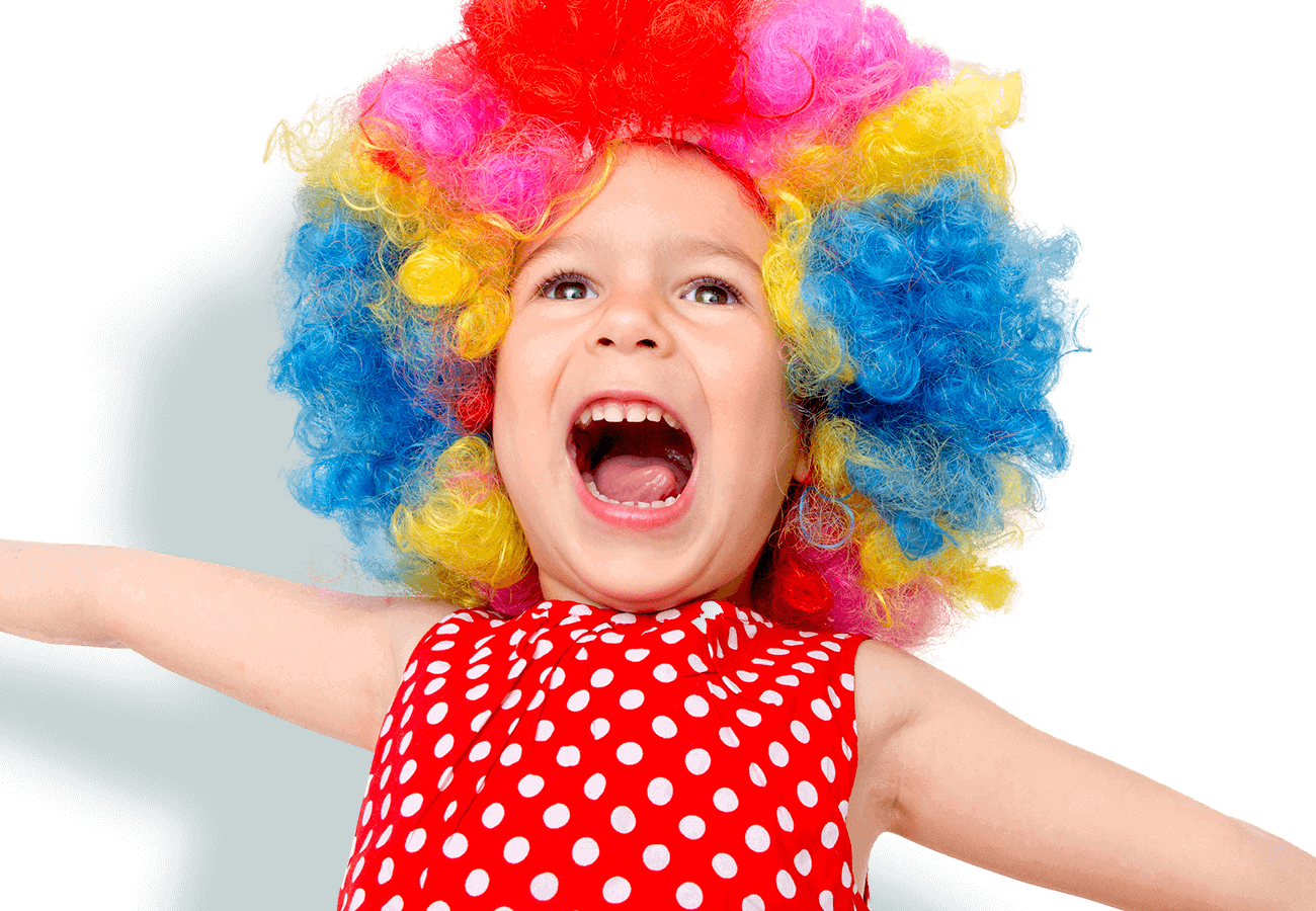 kids klubs gallery page banner photo of girl singing with arms out and wearing a multi-coloured wig
