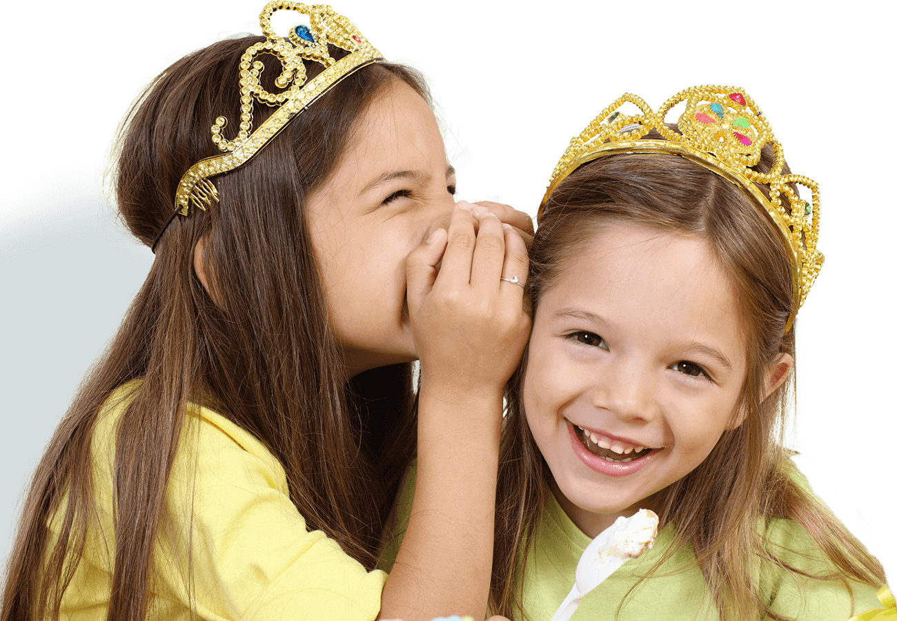 kids klubs gallery page banner photo of two girls dress as princesses, one whispering in the others ear